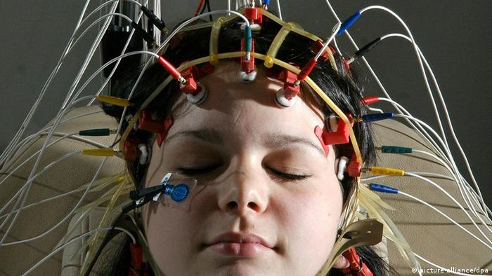 A young woman with electrodes attached to her head