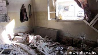 Damages inside a home in Homs