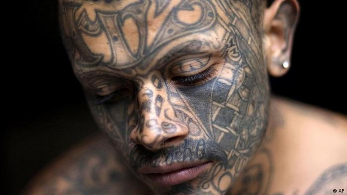 A Guatemalan man with tattoos across his face