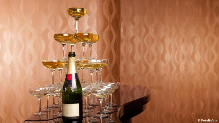 Sparkling wine glasses full of wine form a pyramid
