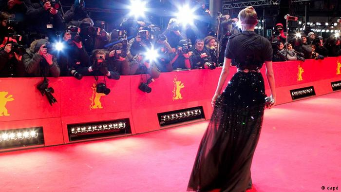 Actress Diane Kruger arrives on the red carpet for the opening ceremony and the screening of the film Farewell My Queen (Les adieux a la Reine) during the 62 edition of International Film Festival Berlinale, in Berlin Thursday, Feb. 9, 2012. (AP Photo/Michael Sohn)
