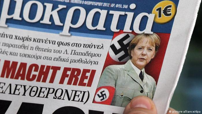 Greek right-wing daily 'Democracy' shows a photoshop photo of German Chancellor Angela Merkel with a Nazi arm band EPA/ORESTIS PANAGIOTOU