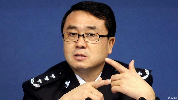 In this Oct. 21, 2008 photo, Chongqing city police chief Wang Lijun reacts during a press conference in the southwestern China city. Wang, the country's most famous policeman, has dropped from sight amid unconfirmed reports of a political scandal and a bid for U.S. asylum. (AP Photo) CHINA OUT