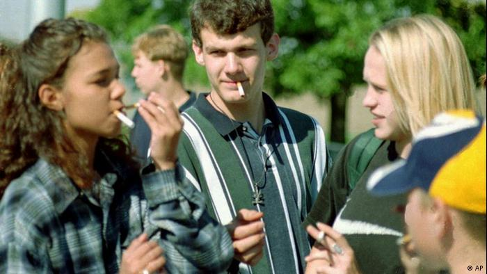 Findlay (Ohio) High School students, from left, Jamie Meyer, Casey Zechman and Nikki Brown take a smoke break at the smoking corner near their high school Tuesday, Oct. 1, 1996. The Findlay City Council is considering a law under which would make it illegal for minors to possess cigarettes or other tobacco products. (AP Photo/Jamie Gill)