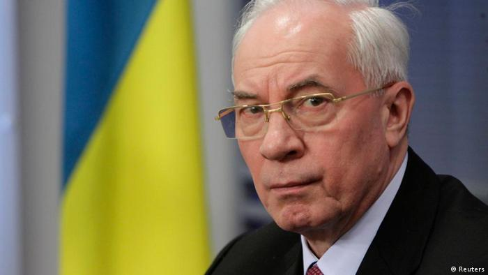 Ukraine's Prime Minister Mykola Azarov listens during a news conference in Riga February 10, 2012.