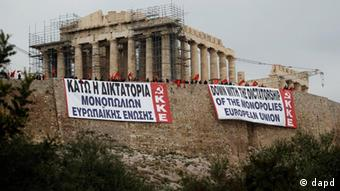 Protests in Greece with banners hanging from the Acropolis