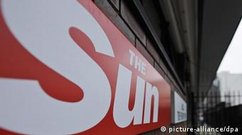 The logo of the British tabloid 'The Sun' outside News International headquarters in Wapping, London, Britain. Photo: EPA/FACUNDO ARRIZABALAGA )