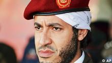 FILE - In this undated file photo made available on Sunday Sept. 25, 2011, Al-Saadi Gadhafi, son of the late Libyan leader Moammar Gadhafi, watches a military exercise by the elite military unit commanded by his brother, Khamis, in Zlitan, Libya. Libya has asked Niger to hand over one of Moammar Gadhafi's sons living under house arrest in the neighboring African nation after he warned his homeland was facing a new uprising. Mohammed Hareizi, spokesman for the ruling National Transitional Council, said Saturday that Niger must comply with the request to extradite Al-Saadi Gadhafi and other officials to preserve its relationship and interests in Libya. (Foto:Abdel Magid al-Fergany, File/AP/dapd) <<