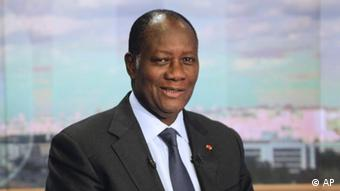 Ivory Coast President Alassane Ouattara poses on the TV set of French channel TF1 prior to an interview (AP Photo/Fred Dufour, Pool)