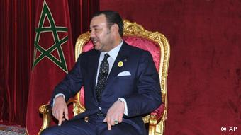 Morroco's King Mohammed VI, seated on a throne . (AP Photo/ Azzouz Boukallouch, HO)