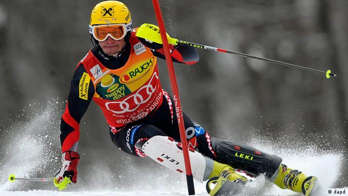 Croatia's Ivica Kostelic slaloms past a pole on his way to win an alpine ski, men's World Cup supercombined, in Krasnaya Polyana near Sochi, Russia, Sunday, Feb. 12, 2012. Ivica Kostelic clinched his second consecutive World Cup super-combined title with a victory Sunday on the 2014 Sochi Olympics course but then hobbled away with an apparent injury. (Foto:Alessandro Trovati/AP/dapd)