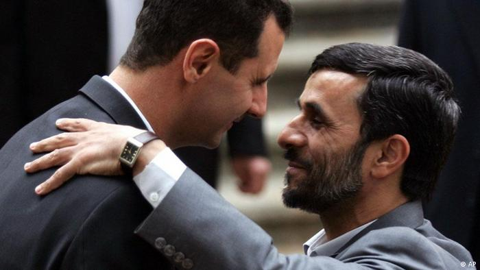 Iranian President Mahmoud Ahmadinejad, right, welcomes his Syrian counterpart Bashar Assad during an official welcoming ceremony for Assad, in Tehran, Iran, Saturday, Feb. 17, 2007. (AP Photo)