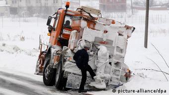 A snow clearing truck slides off a snow covered road in Kosovo, February 2012 Photo: EPA/VALDRIN XHEMAJ