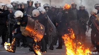 Protestors outside of the Greek parliament clash with police