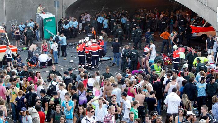 Victims and emergency workers at the site of the Love Parade tragedy in Duisburg in 2010