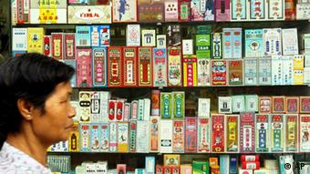 A pedestrian walks past a Chinese pharmacy window display stacked with Chinese medicine packages in Hong Kong(AP Photo/Anat Givon)