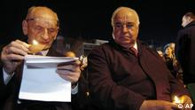 Former Polish Foreign Minister Wladyslaw Bartoszewski, left, and former German Chancellor Helmut Kohl, hold candles during an ecumenical prayer for Europe, attended by Christians, Jews and Muslims, in Gniezno , western Poland, Saturday Sept.17, 2005. The prayer was a part of the 6th Gniezno Convention, a congress about dialogue in Europe.( ddp images/AP Photo/ Remigiusz Sikora)
