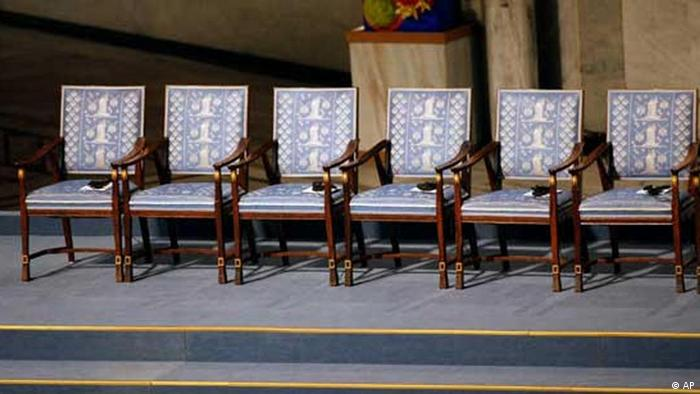An empty chair, second from left with no headests or program, is seen before a ceremony honoring Nobel Peace Prize laureate Liu Xiaobo at city hall in Oslo, Norway Friday Dec. 10, 2010. Liu, a democracy activist, is serving an 11-year prison sentence in China on subversion charges brought after he co-authored a bold call for sweeping changes to Beijing's one-party communist political system. (AP Photo/John McConnico)