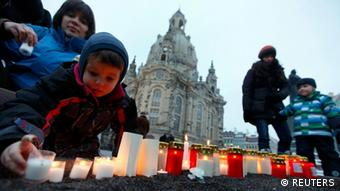 People light candles in front of the Frauenkirche (Church of Our Lady) in Dresden to protest against an Ultra-right activists march through the city centre to commemorate the 67th anniversary of the World War II bombing of the city, February 13, 2012. The destruction of Dresden, in which 25,000 people were killed and flattened the city, sparked a debate about whether breaking public morale through the raids was justifiable since the defeat of Hitler's Nazis was imminent by then. REUTERS/Petr Josek (GERMANY - Tags: ANNIVERSARY CONFLICT POLITICS)