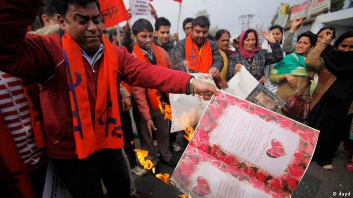 Activists of Hindu group Sri Ram Sena burn cards during a protest against Valentine's Day in Jammu, India, Sunday, Feb. 12, 2012 (Photo: AP Photo/Channi Anand)