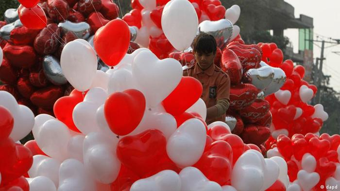 A Pakistani vendor sells heart-shaped balloons for Valentine's Day in Lahore, Pakistan on Monday, Feb. 13, 2012 (Photo: K.M.Chaudary/AP/dapd)