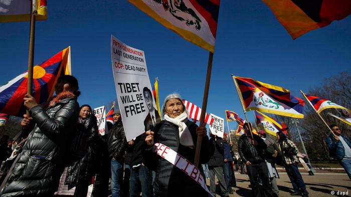 Lhakpa Dolma, 74, center, and other Tibetans and supporters, take part in a demonstration outside the White House in Washington, Monday, Feb. 13, 2012, to draw attention to Tibet before an expected visit to the White House from China's Vice President Xi Jinping. (AP Photo/Jacquelyn Martin)