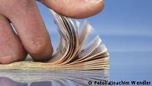 Hand counting money, closeup on blue background with reflections #19166968