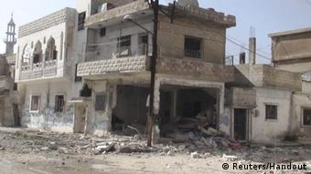 Damaged houses in the city of Homs