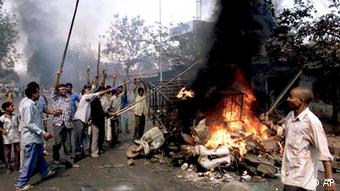 Youths burn vehicles and debris in the streets of Ahmadabad, Gujarat, during 2002 riots