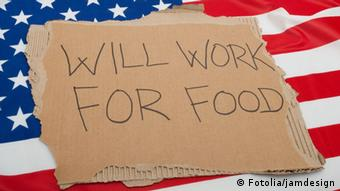 sign reading will work for food and an american flag