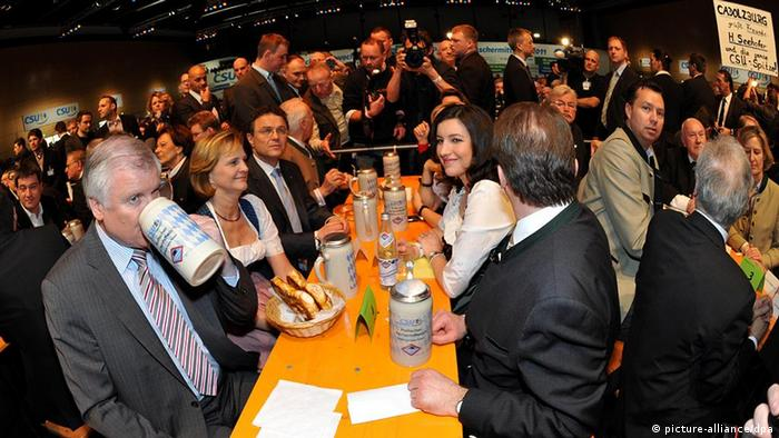 CSU's Horst Seehofer drinks a beer