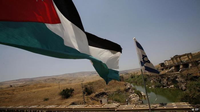 Flags of Jordan and Israel at the Jordan River. (Photo: Oded Balilty)