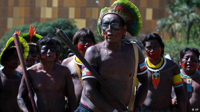 Kaiapo Indians dance in front the National Congress to protest the construction of the Belo Monte hydroelectric dam in Brasilia, Brazil, Tuesday Feb. 8, 2011. A Brazilian environmental agency has given approval for initial work to begin on a massive hydroelectric dam planned for the heart of the Amazon jungle. The 11,000-megawatt project to dam the Xingu River, which feeds the Amazon, would be the third-largest such hydroelectric project in the world. (ddp images/AP Photo/Eraldo Peres)