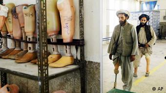 Fateh Khan, right, who lost his leg in battle against the Soviet 15 years ago and Mohammad Ifzal, who lost his leg to a landmine 7 years ago practice walking with new prosthetics provided by the Guardian agency, Sunday Sept. 1, 2002 in Kandahar, Afghanistan's second largest city. (AP Photo/Ed Wray)