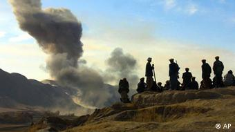 Northern Alliance soldiers watch as U.S. air strikes pound Taliban positions in Kunduz (AP Photo/Ivan Sekretarev)
