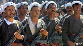 Soldiers under command of northern Afghan leader Gen. Abdul Rashid Dostum march in a military parade in Mazar-e-Sharif, northern Afghanistan, Sunday, April 28, 2002 (AP Photo/Alexander Zemlianichenko)