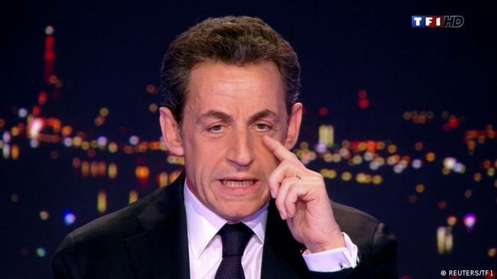 France's President Nicolas Sarkozy, seen in this video grab, appears on France TF1 television prime time news programme as he formally declares his candidacy for a second term at their studios in Boulogne-Billancourt, near Paris, February 15, 2012. REUTERS/TF1 Television/Handout (FRANCE - Tags: POLITICS ELECTIONS) FOR EDITORIAL USE ONLY. NOT FOR SALE FOR MARKETING OR ADVERTISING CAMPAIGNS. THIS IMAGE HAS BEEN SUPPLIED BY A THIRD PARTY. IT IS DISTRIBUTED, EXACTLY AS RECEIVED BY REUTERS, AS A SERVICE TO CLIENTS