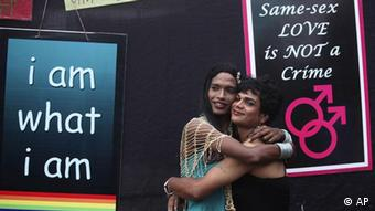 Members of the homosexual, bisexual and transgender community hug each other during a celebration marking the first anniversary of an Indian court's ruling decriminalizing gay sex between consenting adults, in Mumbai, India, Friday, July 2, 2010 (Photo: ddp images/AP/Rafiq Maqbool)