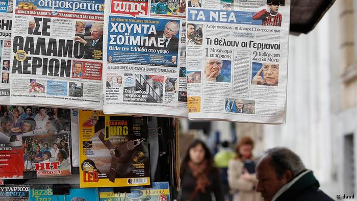 The front pages of three Greek newspapers, depicting German Finance Minister Wolfgang Schaeuble