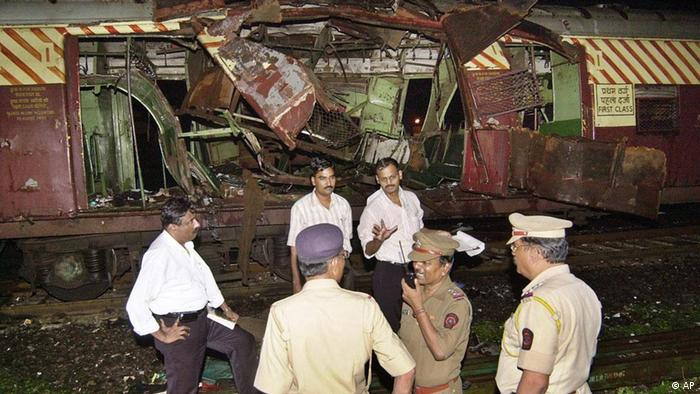Police investigate near a train destroyed by a bomb blast in Mumbai, India on July 11, 2006