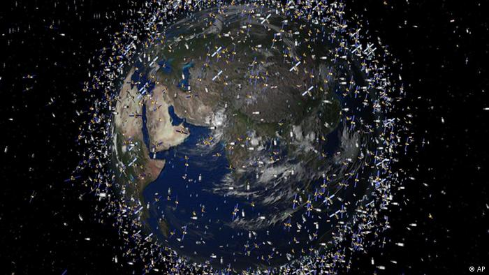 A computer image showing an impression of Earth surrounded by space debris