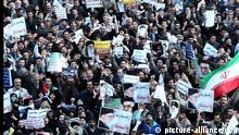 Thousands of Iranian government supporters staging a protest against opposition leaders