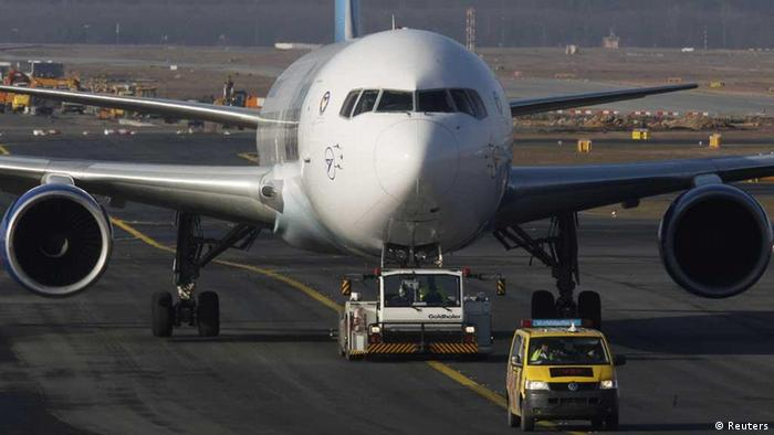 A Lufthansa Boeing B747-400 aircraft is towed on the runway at Frankfurt's airport February 16, 2012. Workers who guide planes in and out of parking slots at Frankfurt airport have widened their plans to strike, which could disrupt more than 1,000 flights at one of Europe's busiest airports. Trade union GdF said on Thursday it was calling for a second day of walkouts, asking about 200 apron controllers to walk off the job for 14 hours on Friday in addition to a seven-hour strike planned from 1400 GMT on Thursday. REUTERS/Alex Domanski (GERMANY - Tags: TRANSPORT BUSINESS EMPLOYMENT CIVIL UNREST)