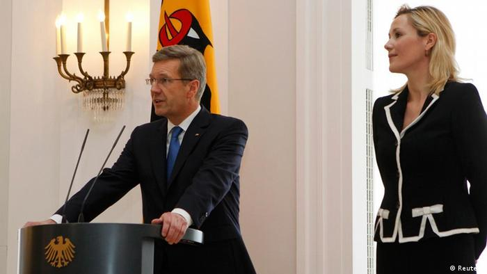 German President Christian Wulff makes a statement in the presidential residence Bellevue Palace in Berlin, February 17, 2012, next to his wife Bettina. Wullf on Friday announced his resignation. REUTERS/Fabrizio Bensch (GERMANY - Tags: POLITICS)