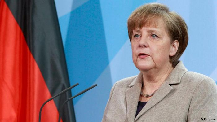 German Chancellor Angela Merkel makes a statement at the Chancellery in Berlin