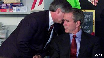 President Bush's Chief of Staff Andy Card whispers into the ear of the President to give him word of the plane crashes into the World Trade Center, during a visit to the Emma E. Booker Elementary School in Sarasota, Fla., Tuesday, Sept. 11, 2001. Photo: AP Photo/Doug Mills