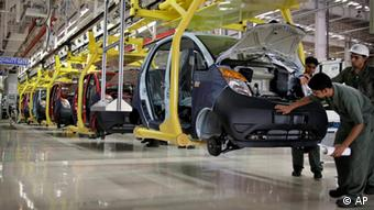 Employees of Tata Motors work on the assembly line of a Nano car during the inauguration of the Nano plant in Sanand, about 40 kilometers (25 miles) from Ahmadabad, India, Wednesday, June 2, 2010 (AP Photo/Ajit Solanki)