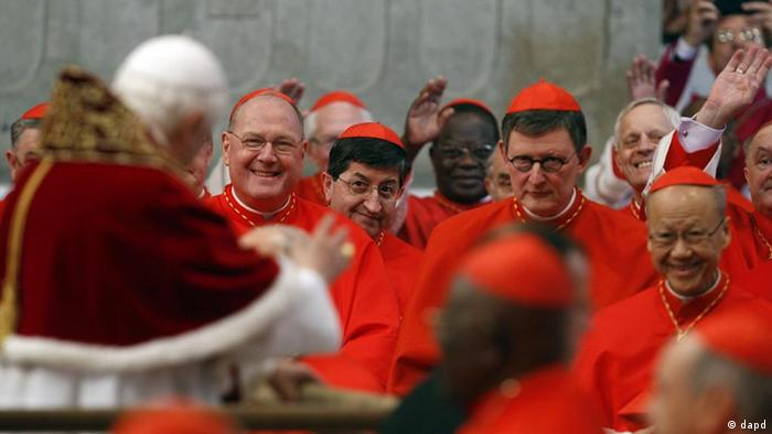 Pope Benedict XVI, left, greets newly appointed cardinals, from left, Timothy Michael Dolan of the United States, Giuseppe Betori of Italy, Rainer Maria Woelki, of Germany, and John Tong of Hong Kong, in St. Peter's basilica at the Vatican, Saturday, Feb. 18, 2012. Pope Benedict XVI on Saturday brought 22 new Catholic churchmen into the elite club of cardinals who will elect his successor, in a greatly simplified ceremony that took account of evidence the 84-year-old pontiff is slowing down. (Foto:Andrew Medichini/AP/dapd)