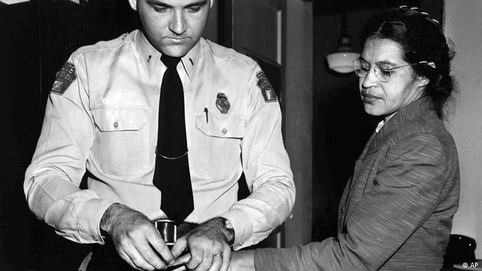 Rosa Parks, whose refusal to move to the back of a bus touched off the Montgomery bus boycott and the beginning of the civil rights movement, is fingerprinted by police Lt. D.H. Lackey in Montgomery, Ala., Feb. 22, 1956. She was among some 100 people charged with violating segregation laws. (AP Photo/Gene Herrick)