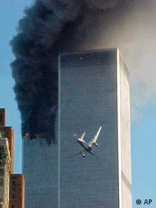 A jet airliner is lined up on one of the World Trade Center towers in New York Tuesday, Sept. 11, 2001. In the most devastating terrorist onslaughts ever waged against the United States, knife-wielding hijackers crashed two airliners into the World Trade Center on Tuesday, toppling its twin 110-story towers. (AP Photo/Carmen Taylor)